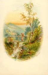 woman and child on bridge over waterfall