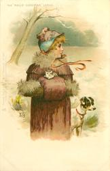 snow scene, girl in cape and muff, carrying kitten, terrier stands beside