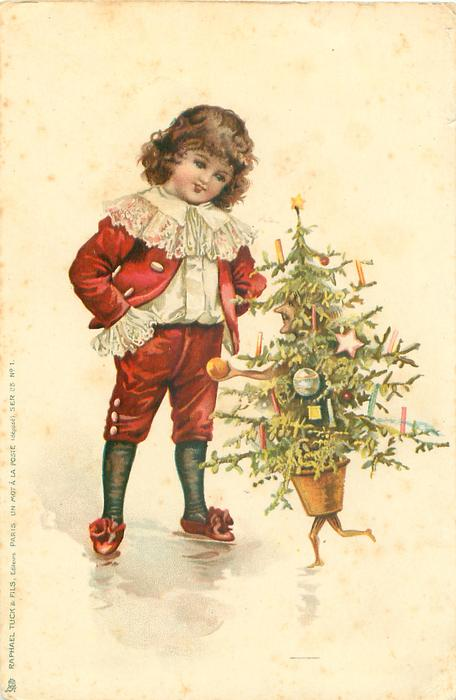 boy in red talks to a personised Christmas tree
