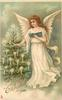 A HAPPY CHRISTMAS TO YOU  angel with short taper in one hand lighting tree, holds book with other hand