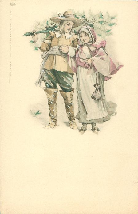 boy & girl stand together holding hands in snow, he has Xmas tree across his shoulder