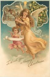 TO WISH YOU A HAPPY CHRISTMAS angel in brown holding lyre, inset top