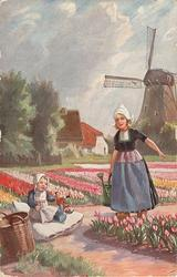 woman carries watering can, young child plays with doll on large white cushion, many tulips,windmill back on right