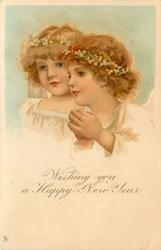 WISHING YOU A HAPPY NEW YEAR  two angels girls looking left, one prays