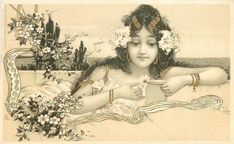 girl facing front, picking daisy petal