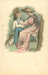 woman seated, reading to young boy in sailor suit, dog sits by him, rural scene