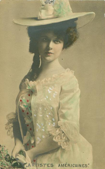 3/4 study of girl wearing large hat facing partly left, looking front, hands clasped in front
