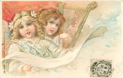 two angels, one plays lyre, the other holds a scroll