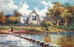 BOLTON ABBEY (girl on stepping stones in water in front of abbey)