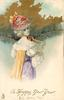 A HAPPY NEW YEAR  girl in white/yellow/violet dress and floral hat, faces right & looks back over her shoulder