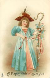 A HAPPY CHRISTMAS TO YOU  girl in blue over peach dress, with deep red hat, carries flowery shepherds crook