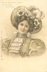 woman in hat trimmed with ostrich feathers & flowers faces partly left, looks up to the right