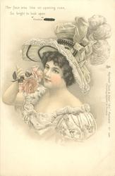 woman in hat trimmed with ostrIch feathers holds rose to her face, faces partly left, looks up
