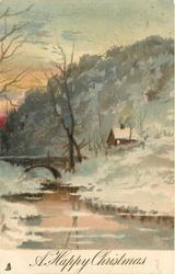 A HAPPY CHRISTMAS  bridge left, water front, cottage right, much grey snow & trees behind