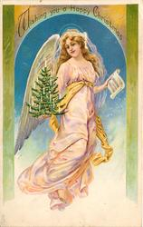 WISHING YOU A HAPPY CHRISTMAS  angel in pink carrying christmas tree & hymn sheet