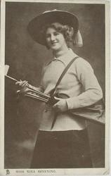 MISS NINA SEVENING in golf attire with bag of clubs, facing left