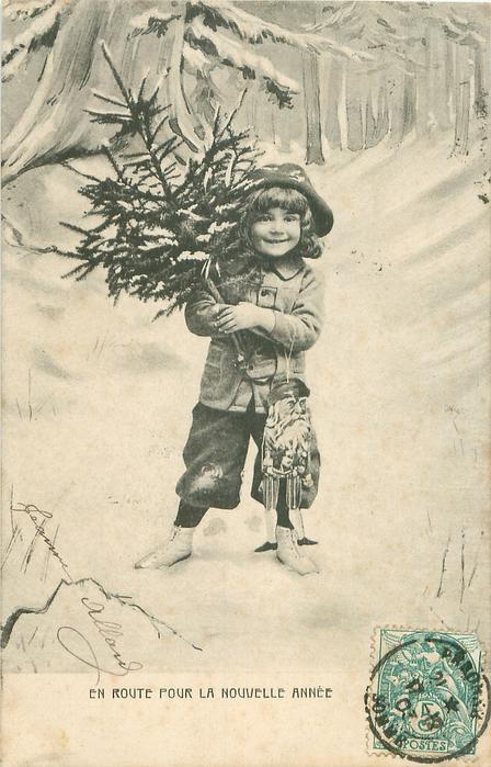 EN ROUTE POUR LA NOUVELLE ANNEE boy stands in snow carrying tree & Santa puppet