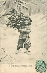EN ROUTE POUR LA NOUVELLE ANNEE boy stands in snow carrying tree & Santa puppet