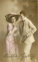 woman left looking front, man right holding hat gazing at her face