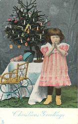 CHRISTMAS GREETINGS  girl stands praying to right of Xmas tree