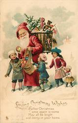LOVING CHRISTMAS WISHES.   Santa with toys & four children walk left in snow