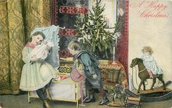 A HAPPY CHRISTMAS. girl sits on cot cuddling doll, boy looks on, many toys