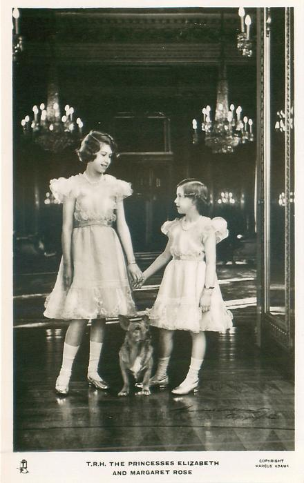 T.R.H. THE PRINCESSES ELIZABETH AND MARGARET ROSE  both standing, corgi between them