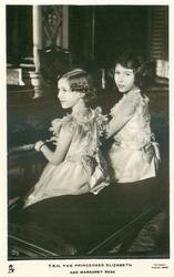 T.R.H. THE PRINCESSES ELIZABETH AND MARGARET ROSE  sitting side by side at piano