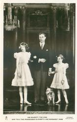 HIS MAJESTY THE KING AND T.R.H. THE PRINCESSES ELIZABETH AND MARGARET ROSE  all standing, corgi between king & margaret rose