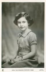 H.R.H. THE PRINCESS MARGARET ROSE  sitting on bench with hands in lap, striped blouse