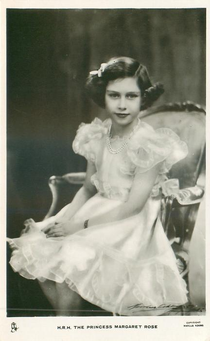 H.R.H. THE PRINCESS MARGARET ROSE  sitting on chair with hands in lap, fancy dress & pearls