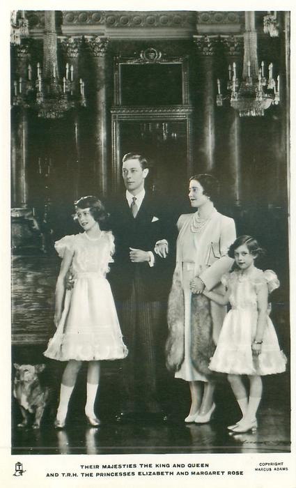 THEIR MAJESTIES THE KING AND QUEEN AND T.R.H. THE PRINCESSES ELIZABETH AND MARGARET ROSE  all standing, corgi to left of card