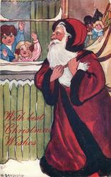 Santa with sack of toys, including golly, two children wave from window