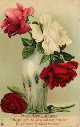 tall green & cream vase with peacock feather design, pink rose left, white & red right, another red rose lying on table