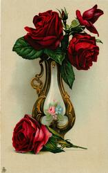 vase, floral design within gold, three red roses & bud & another one laying on table