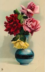 blue glass  vase, two pink roses right, one red, one yellow left