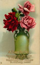 green vase with two handles, red rose left, two pink, roses right