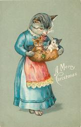 A MERRY CHRISTMAS mother cat in blue dress, red apron, holding basket containing four kittens