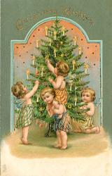 CHRISTMAS WISHES   four smalll angels around Xmas tree, one piggyback