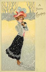 A HAPPY CHRISTMAS  woman stands  on skates in snowstorm holding muff up to neck with both hands
