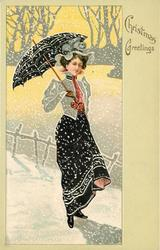 CHRISTMAS GREETINGS  woman with umbrella stands facing right in snowstorm