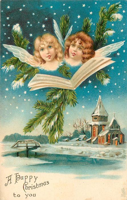 A HAPPY CHRISTMAS TO YOU  heads of two angels singing, hymn sheet, evergreen above lighted chuch below right, bridge left, water front