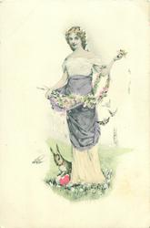 woman carrying pussy-willow & flowers in her skirt, faces front, rabbit & eggs below left