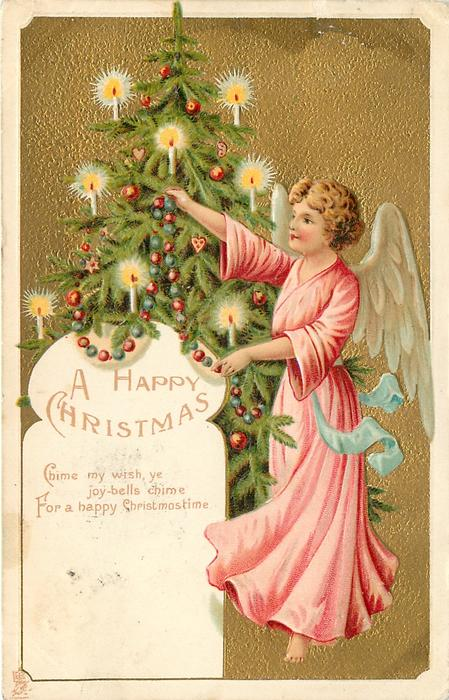 A HAPPY CHRISTMAS   angel in deep pink robe to right of Xmas tree