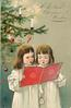 WITH BEST CHRISTMAS WISHES  two children dressed in white sing from red sheet, below Xmas tree