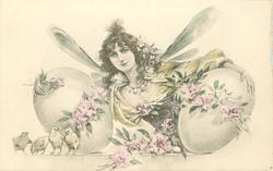 girl with dragonfly wings holds large egg under each arm, four chicks front left