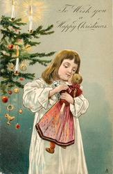 TO WISH YOU A HAPPY CHRISTMAS girl  in white dress holding doll with purple dress, Xmas tree behind left