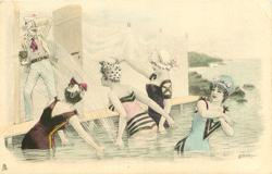 four girls in sea splash man with camera standing in door of bathing hut