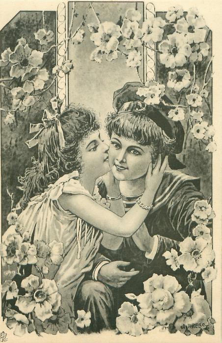 girl kisses older child in sailor suit