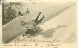 man up on arms on sleigh moving left/front, legs wide spread